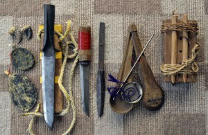Traditional tools used by Matagi include a hand-forged bear hunting knife called Fukuronagasa (second from the left) and a scale to weight bear's gallbladder called Monmebakari  (fifth from the left).