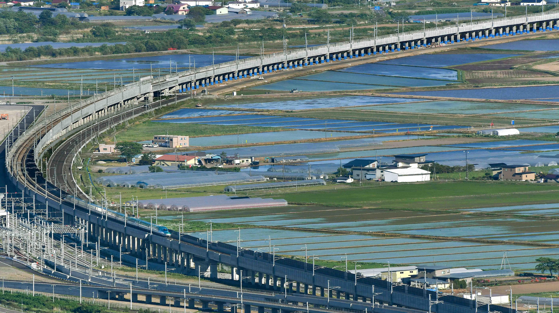 Hokkaido Shinkansen crossing Ohno Plain on the arch-shaped track (in Hokuto-shi, Hokkaido)