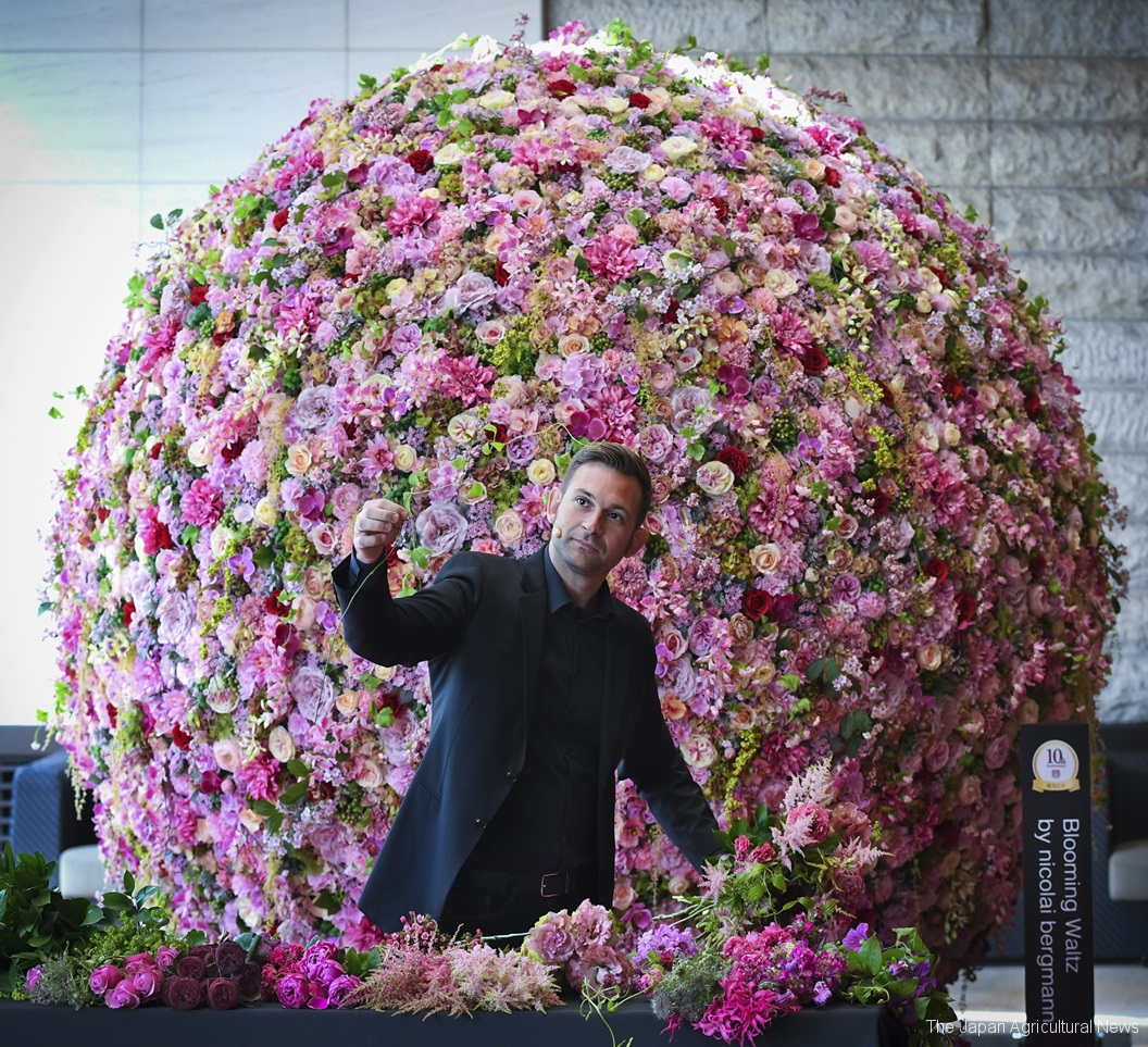 Nicolai Bergmann performs ikebana flower arrangement in front of his work in the Marunouchi district of Tokyo.