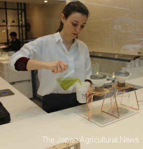 An employee of Maruzen Tea Roastery in the city of Shizuoka brews tea using tea leaves roasted at a temperature chosen by a customer.