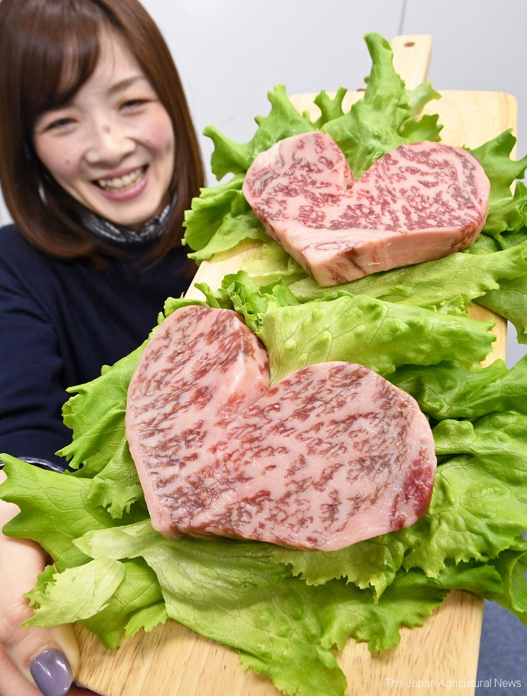 Heart-shaped wagyu beef are on green lettuce at Takashimaya in Tokyo.