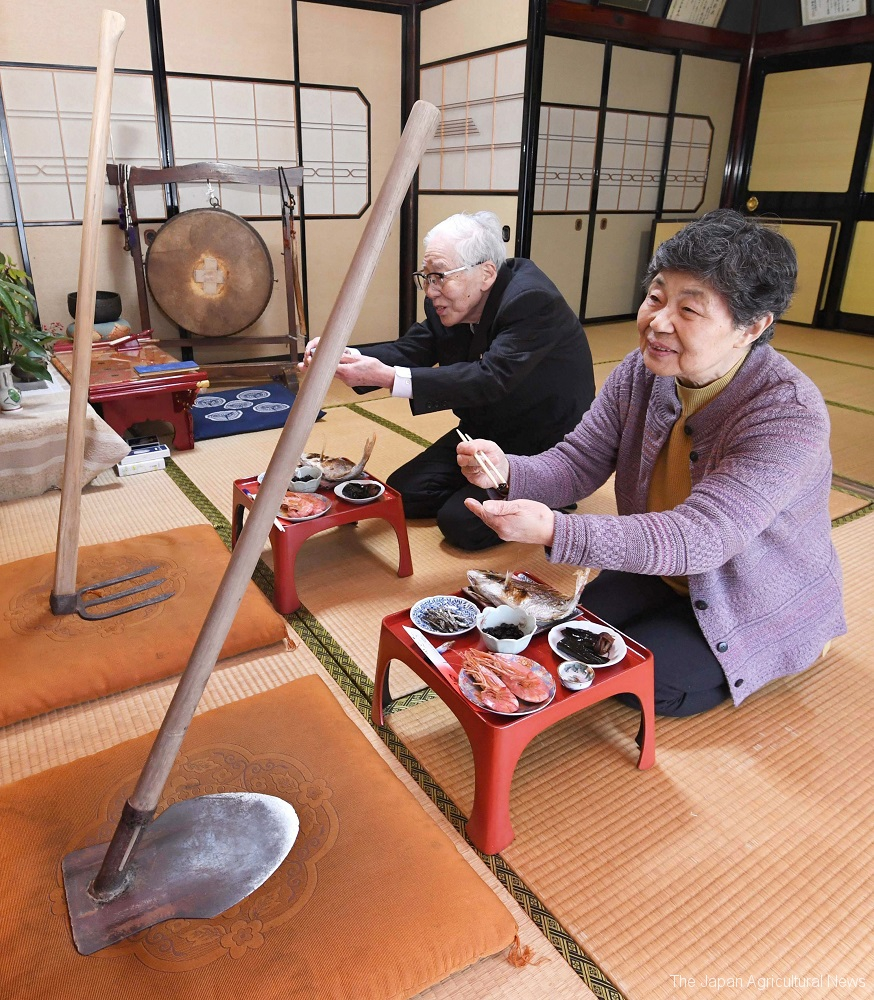 The Japanese couple serve New Year's feast to hoes to pray for a good harvest year in Toyama prefecture.