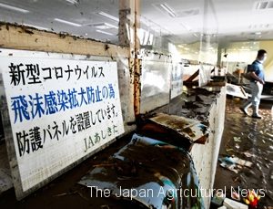 The main office of JA Ashikita in Ashikita, Kumamoto Prefecture, is seen covered with muddy water on July 5 as a nearby river overflowed following a torrential rain.