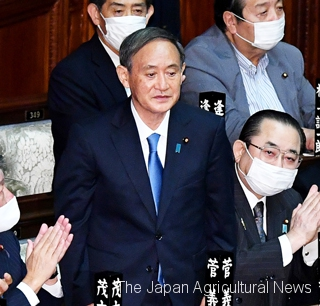 1.Yoshihide Suga stands up after being elected the new prime minister at the Upper House on Sept. 16.