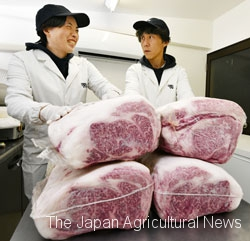 Tanaka buys back carcass from meat centers and sells them at his own meat shop. His 33-year-old wife, Atsumi (left), cuts and packs the meat for sale.