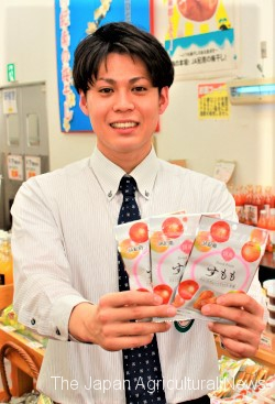 Aki Okazaki shows dried Japanese plums sold by JA Kinan in Tanabe, Wakayama Prefecture.